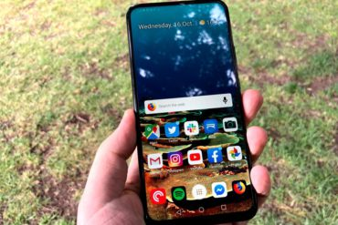 Hand holding Huawei Y9 Prime smartphone